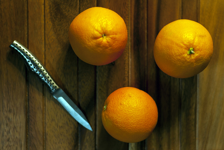 Delicious Sweet Whole Oranges On Wood Table With Cutting Knife
