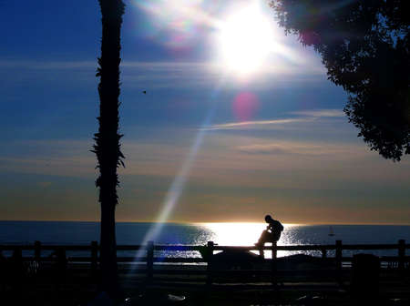 Silhouette of Man Playing Guitar By the Sea photo