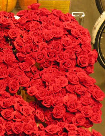 dozens: Dozens of fresh red roses for sale on street