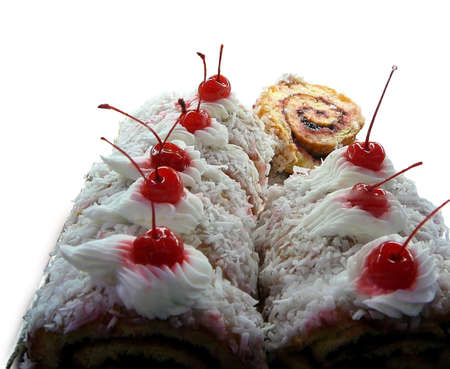 decadent: Detail of Decadent Coconut Roll Cake with Cherries on Top