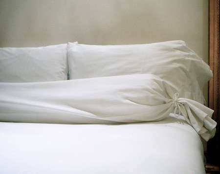 Pillows Against Bed Headboard