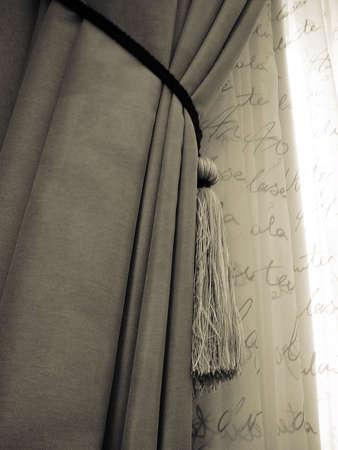 Elaborate Drapery in Window with Tassles