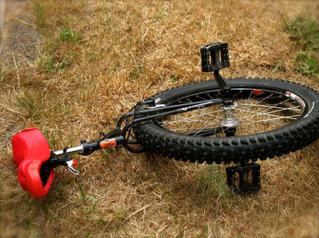traction: A unicycle with red seat at rest Stock Photo