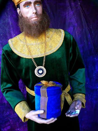 Mannequin bearing gift in Christmas Nativity Scene Stock Photo