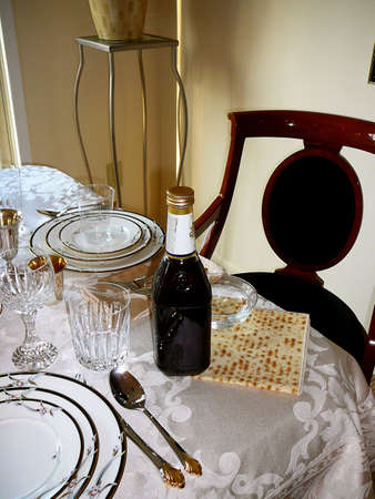 matzot: Empty Seat at Table with Wine and Matzah for Traditional Passover Seder