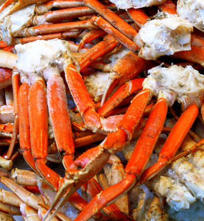 animal leg: Pile of Fresh Crab for sale at Seafood Market Stock Photo