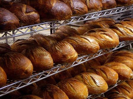 Shelves of fresh baked loaves of artisan bread