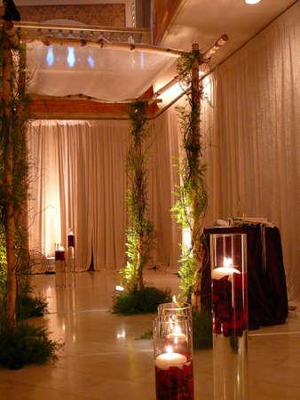 elaborate: Elaborate chuppah with green vines at Jewish wedding