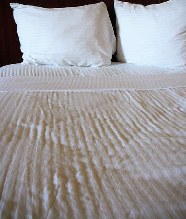 Luxuus bed with black headboard and white striped sheets Stock Photo - 912960