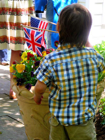 Young Boy Holding British and American Flags 免版税图像