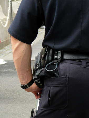 walkie: Detail of Policemans Uniform: Walkie Talkie on Holster Stock Photo