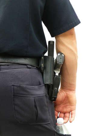 holster: Detalle de la polic�a de uniforme: Gun y el agua embotellada en Holster aislados en Fondo blanco  Foto de archivo