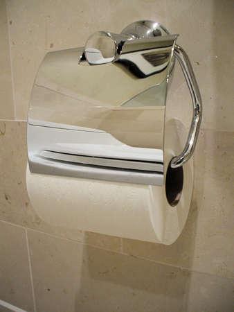 Closeup of toilet paper in bathroom photo