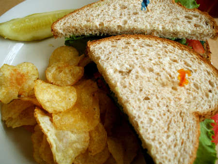 Turkey BLT Sandwich with Potato Chips at Diner photo