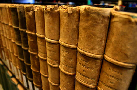 Close-up of Shelf of Leather Bound Books in Library Stock Photo