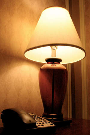 bedside: Bedside Table with Lamp and Telephone Stock Photo