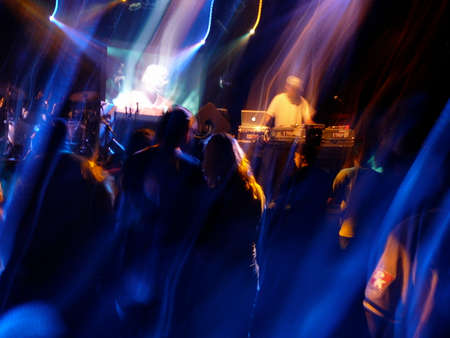 DJ spins music at crowded concert venue