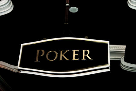 Sign Over Poker Table in Casino Stock Photo