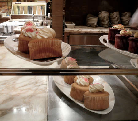 bakery products: Gourmet Cupcake Display in Elegant Bakery Display