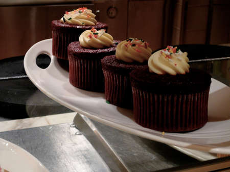 Gourmet Red Velvet Cupcake Display in Elegant Bakery Display photo