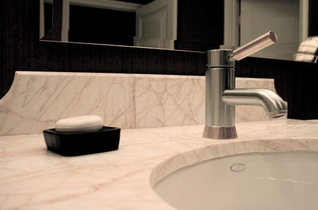 Modern Faucet and Sink with Soapdish in Elegant Restroom Stock Photo