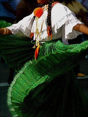 folk festival: Traditional Folk Dancer in Green Pleated Skirt Performs in outdoor festival, Brooklyn, New York