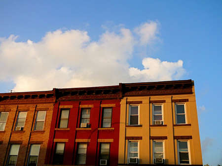 Colorful row of apartment buildings on block in Brooklyn, New York