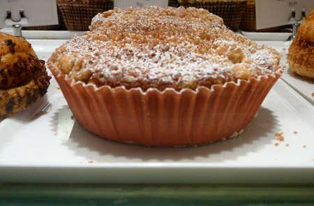 Miniature Individual Autumn Apple Crumble Pie in Bakery Display photo