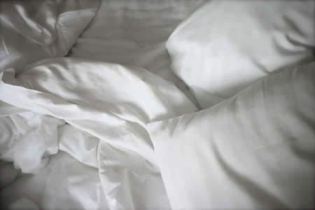 Crumpled white bed sheets
