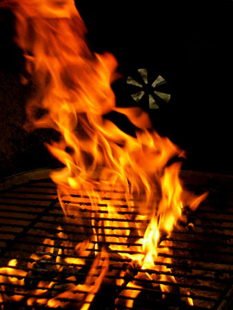 Closeup detail of fire in outdoor BBQ charcoal grill Stock Photo