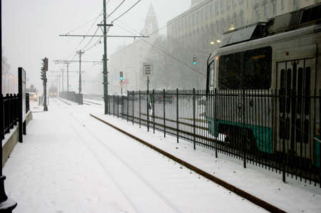 arrives: Commuter train arrives in outdoor station during snowstorm, Boston