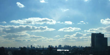 boroughs: Vista Overlooking Silhouetted City Skyline of Manhattan and Brooklyn