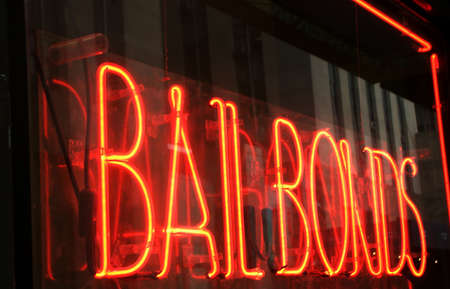 Red Neon Bail Bonds Sign on Urban Storefront