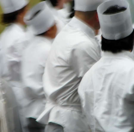 Abstract blur of group of chefs in traditional white uniform photo