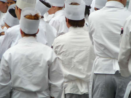 Group of chefs in traditional white uniform