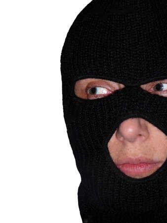 Female Burglar Wearing Black Ski Mask Isolated Over White photo