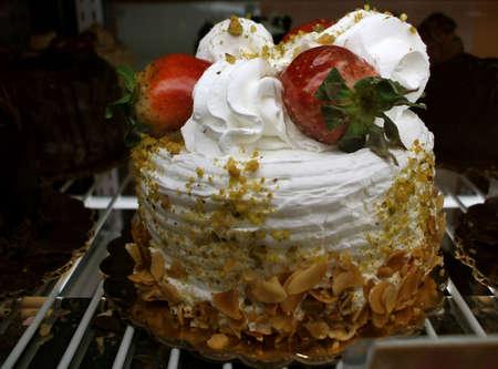 decadent: Decadent Strawberries and Vanilla Cream Birthday Cake Stock Photo