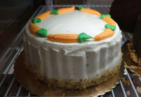 decadent: Still Life of Decadent Carrot Cake Cupcake With Cream Cheese Frosting Stock Photo