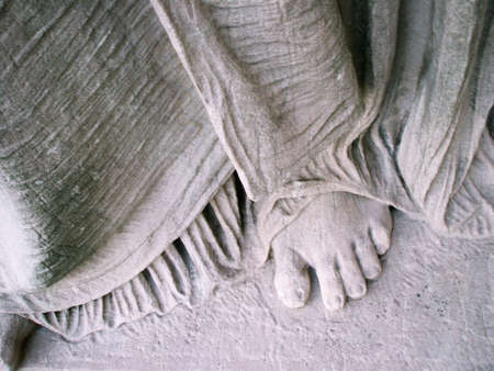 body dimensions: Figure Study: Classical Sculpture Detail of Stone Foot Form and Drapery Stock Photo
