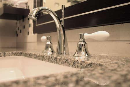 Bathroom Still Life: Elegant Chrome Faucet and Sink photo