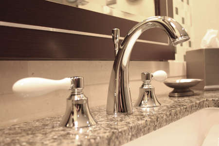 Bathroom Still Life: Elegant Chrome Faucet and Sink