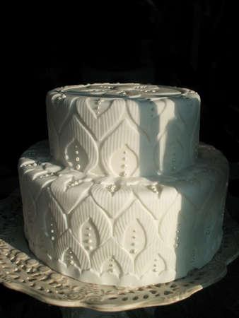 Elaborate White Wedding Cake on Cake Stand Isolated Over Black Background Stock Photo - 2680648