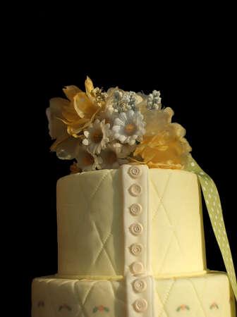 elaborate: Elaborate Pastel Yellow Floral Cake Isolated Over Black Background