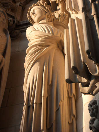 Female Sculpture on Facade of Monumental Saint John the Divine Cathedral, New York City photo