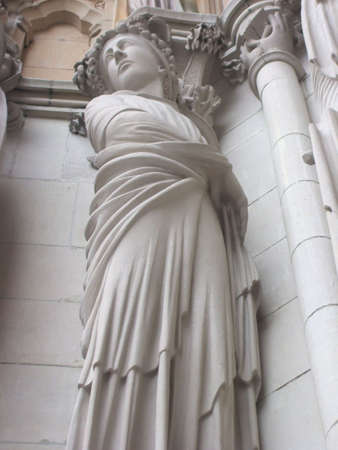Female Sculpture on Facade of Saint John the Divine Cathedral, New York City. Largest cathedral in the United States, longest cathedral in the world.