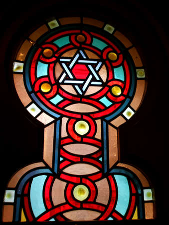 stained glass windows: Stained Glass Window with Star of David in Jewish Synagogue Interior Stock Photo