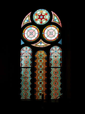 Stained Glass Windows with Star of David Designs in Jewish Synagogue Interior