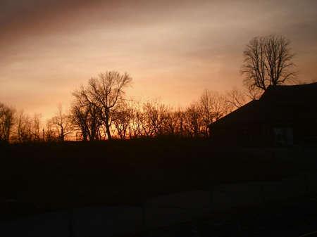 Rural Farm at Sunset in Stark Winter Season photo
