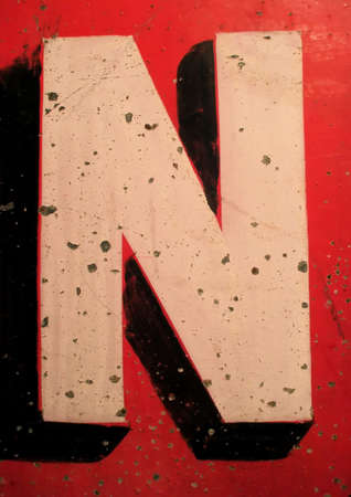 old english: Letter N on Antique Tin Sign with Peeling Paint