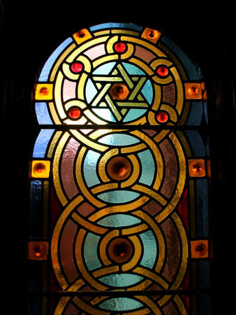 Stained Glass Windows with Star of David Designs in Jewish Synagogue Interior photo